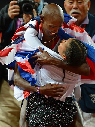 Mo Farah of Britain hugs his daughter Rihanna after winning gold in